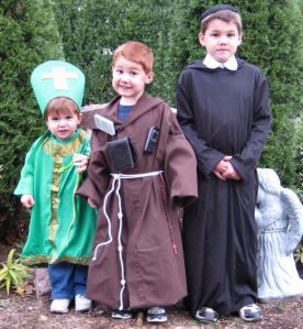 young children dressed as saints